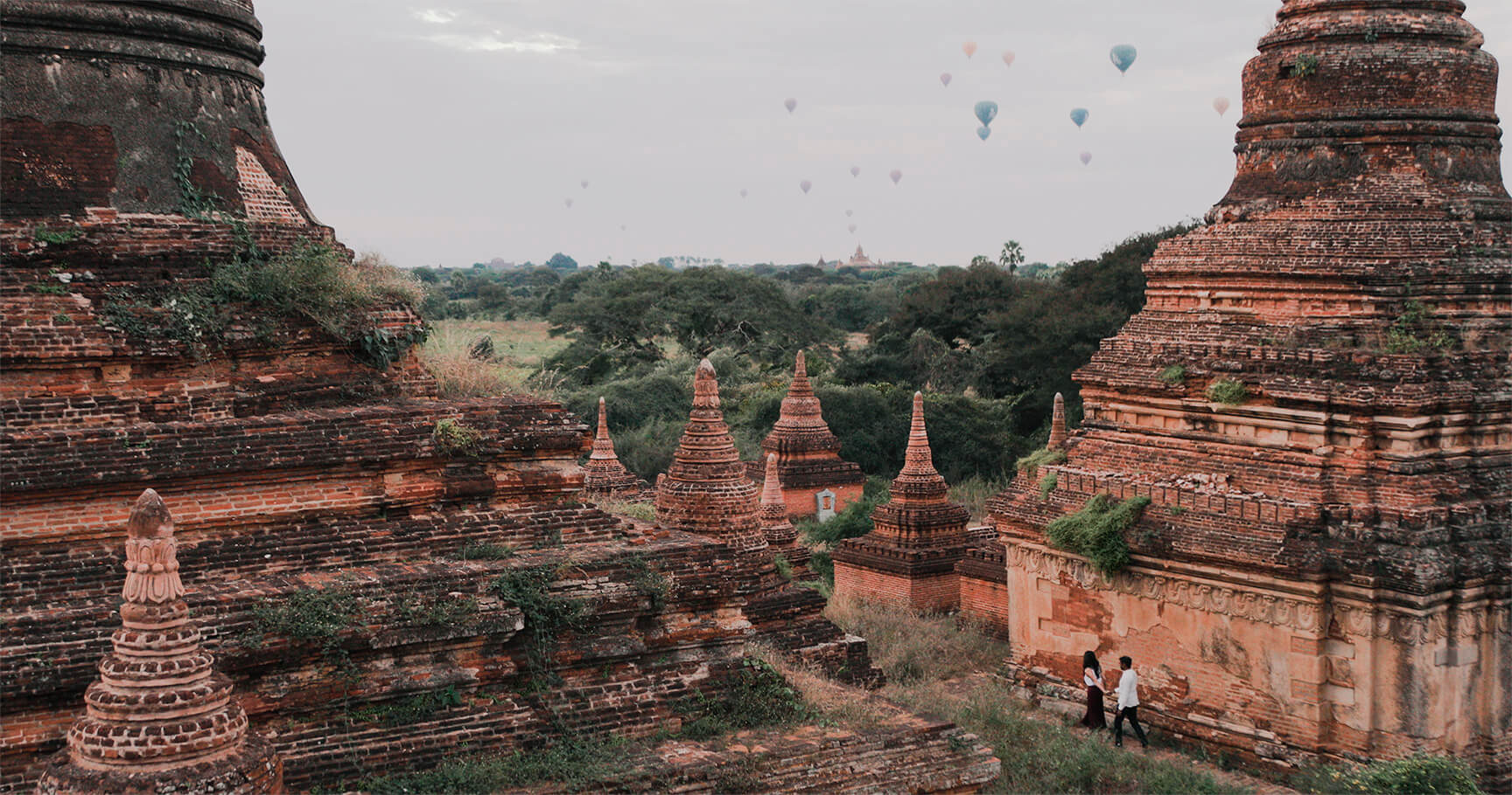Wedding Couple in Bagan, Myanmar with Hot Air Balloons at Sunrise. Video by Sculpting With Time. Photos by Marko Marinkovic.